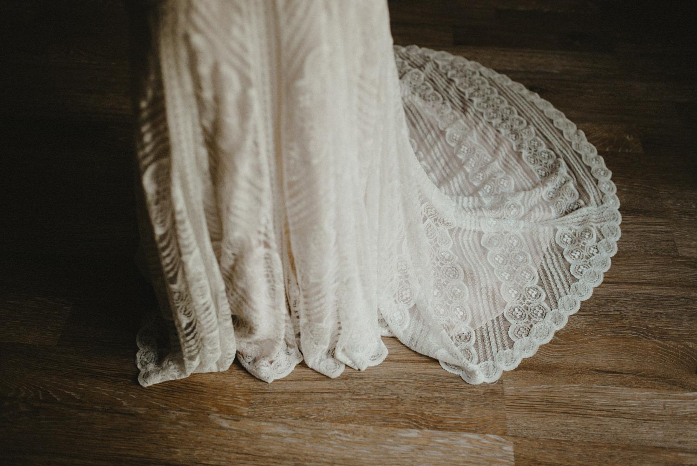 white wedding dress on dark background