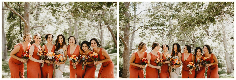 bridesmaids in burnt red bridesmaid dresses.