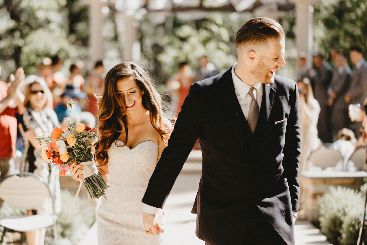 bride and groom walk out of wedding ceremony