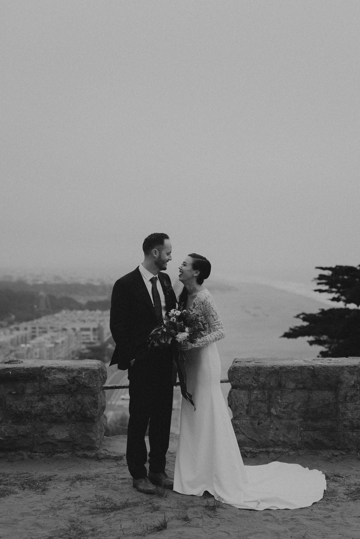 bride and groom above Golden Gate Park in Sutro Heights Park.jpg