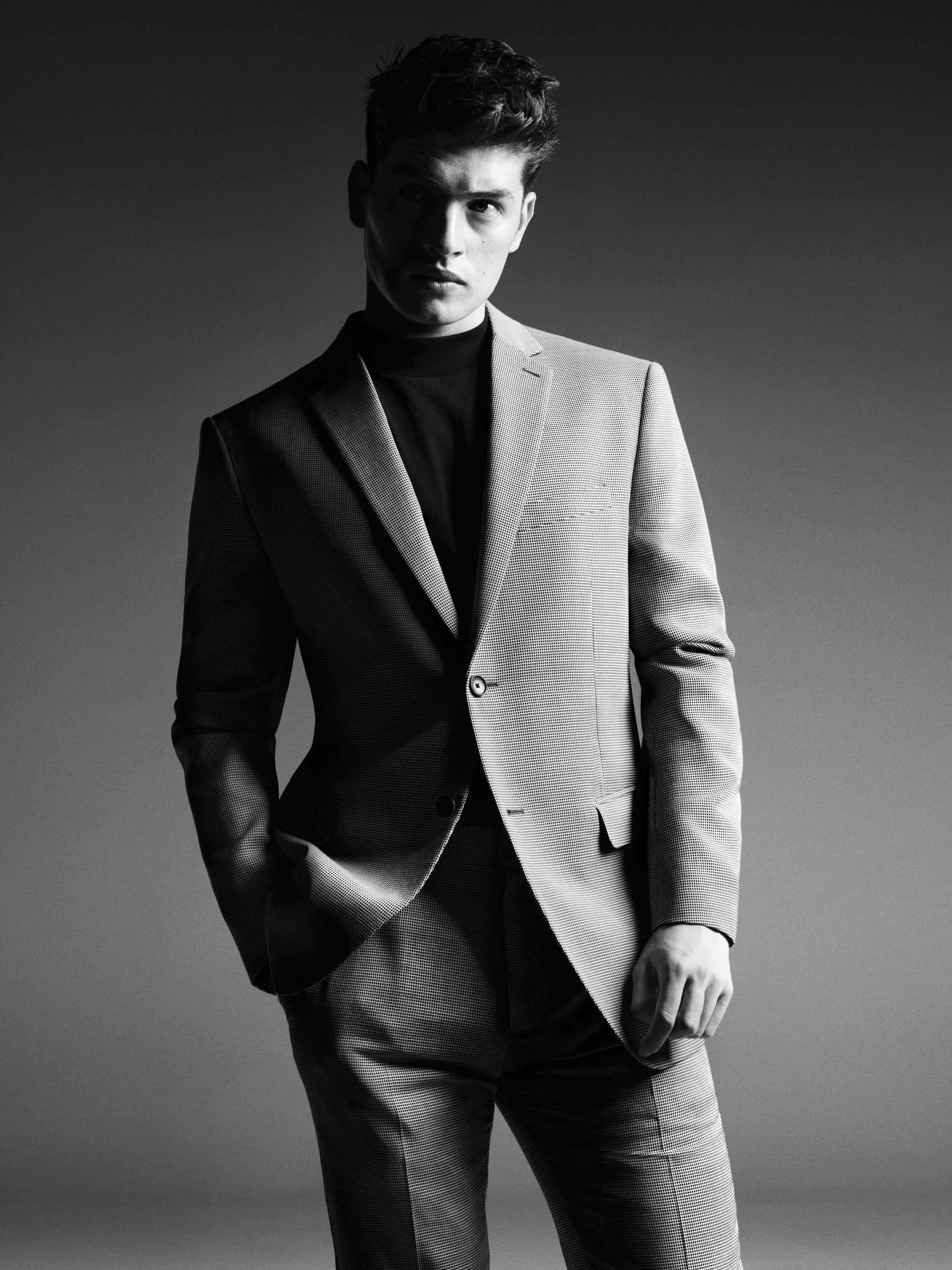 Suit by   THEORY  , Shirt by   CALVIN KLEIN COLLECTION  .