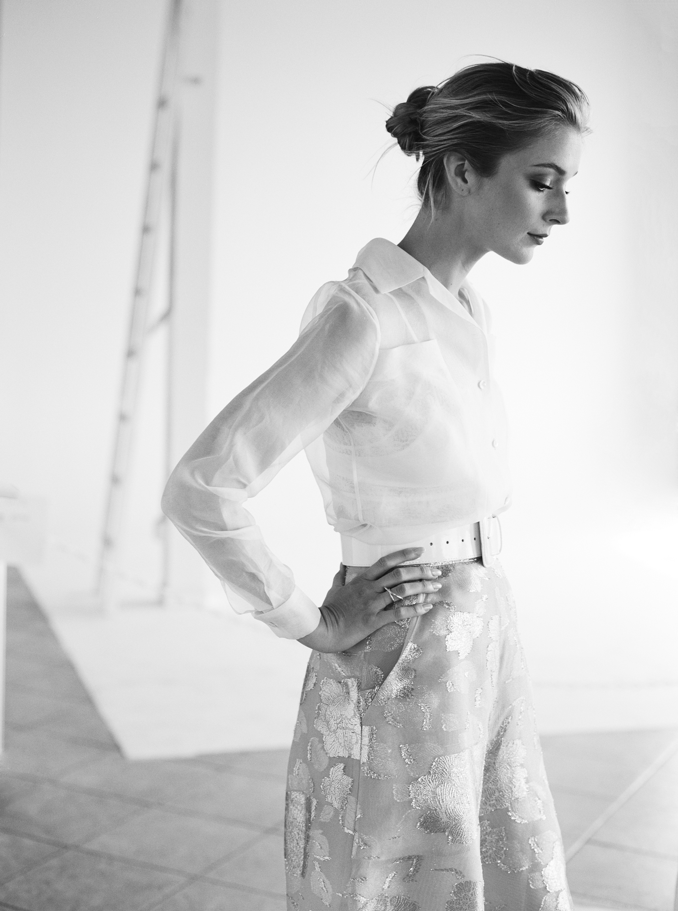 Shirt, skirt and belt by  THE 2ND SKIN CO.  ,Bra by  FOR LOVE AND LEMONS  ,Ring by  PSYCHE JEWELRY .