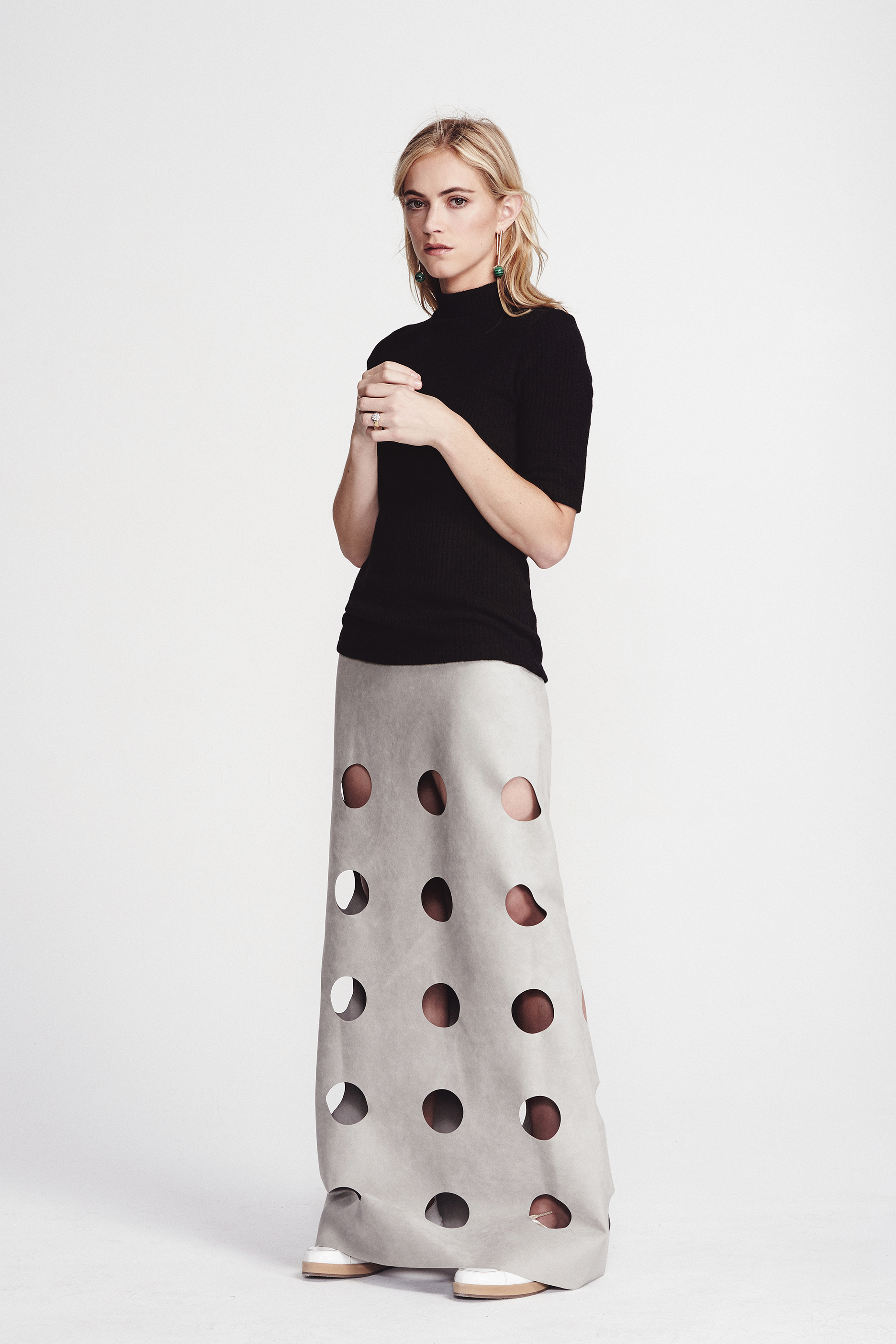 Top by   ASSEMBLY NEW YORK ,  Skirt by   CF. GOLDMAN   courtesy of   ASSEMBLY LOS ANGELES  , Shoes by   MAIYET  , Earrings by   ZARA  , Ring by   CARTIER  .