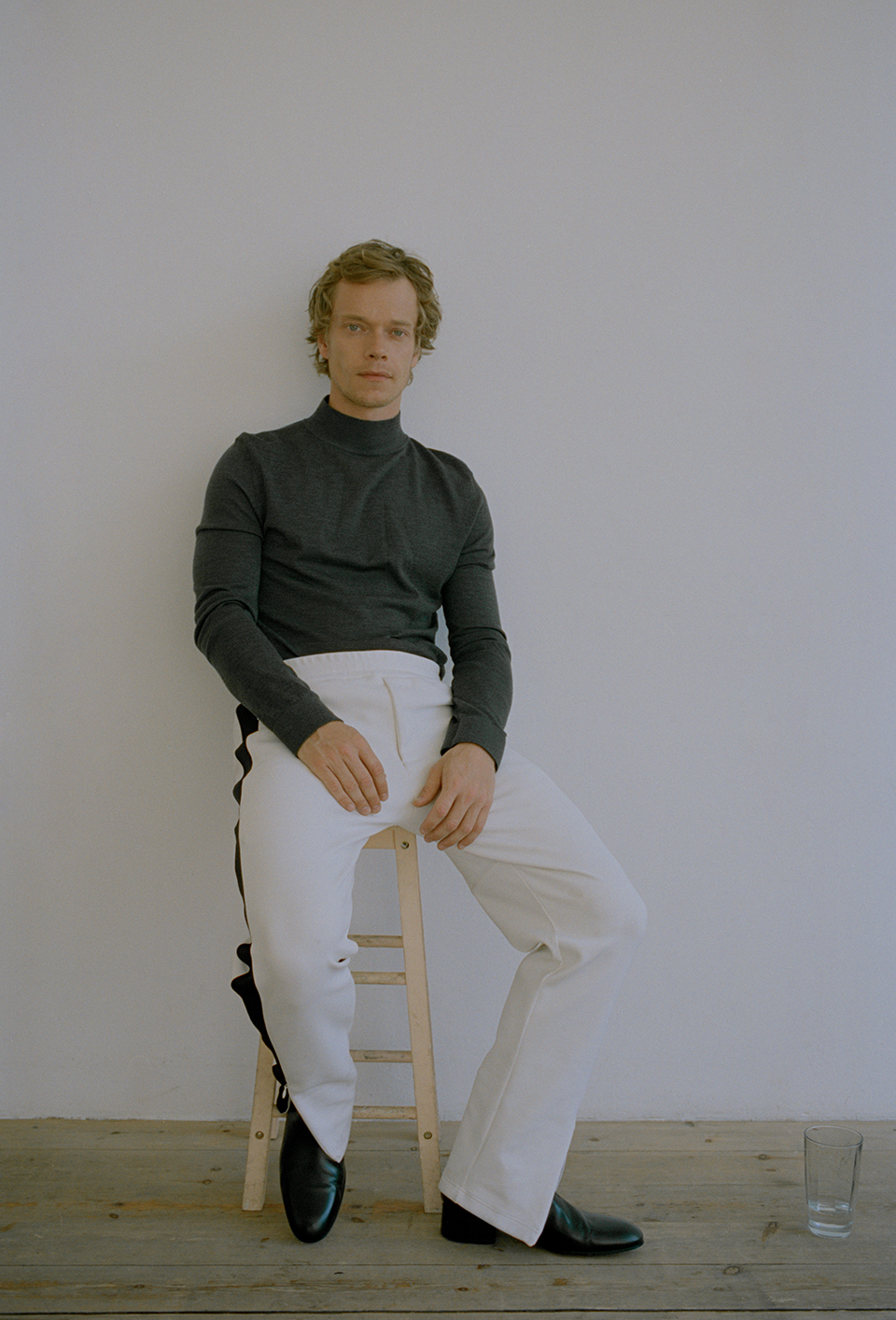 Knit by   NICOLE FARHI  , Track pants by   JOSEPH  , Boots by   PAUL SMITH