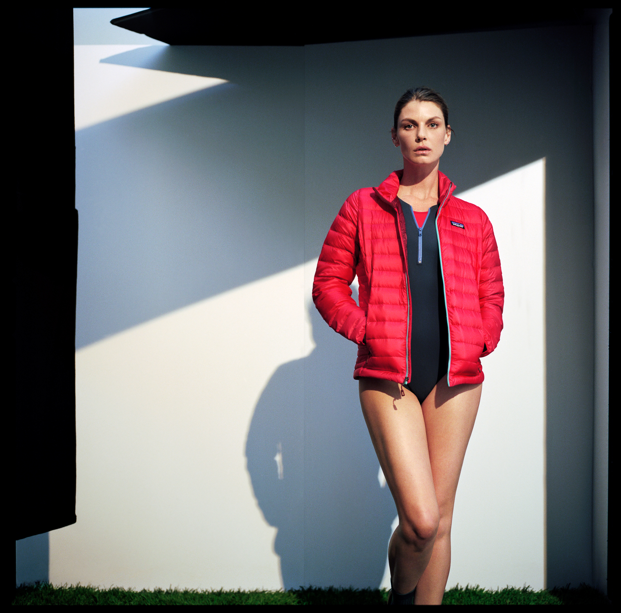 Run Bra in Red (worn underneath) by   TRACKSMITH  , Stella Swimsuit by   FLAGPOLE   ,  Down Sweater Jacket by   PATAGONIA