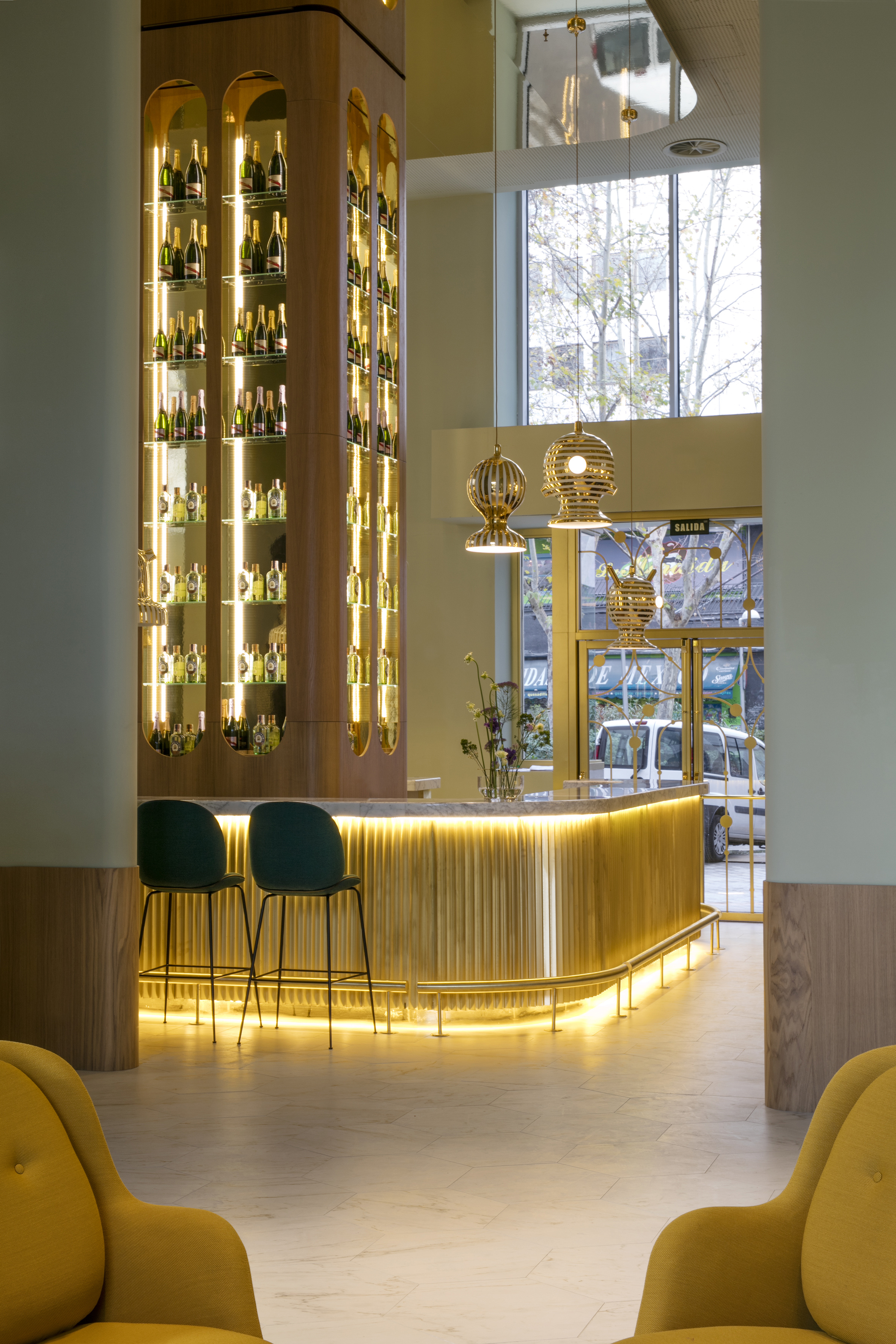 Garra Lobby Bar: Fri armchairs by Fritz Hansen; Beetle stool by Gubi; Ceramic hanging lights special design by Jaime Hayon for Hotel Barceló Torre de Madrid
