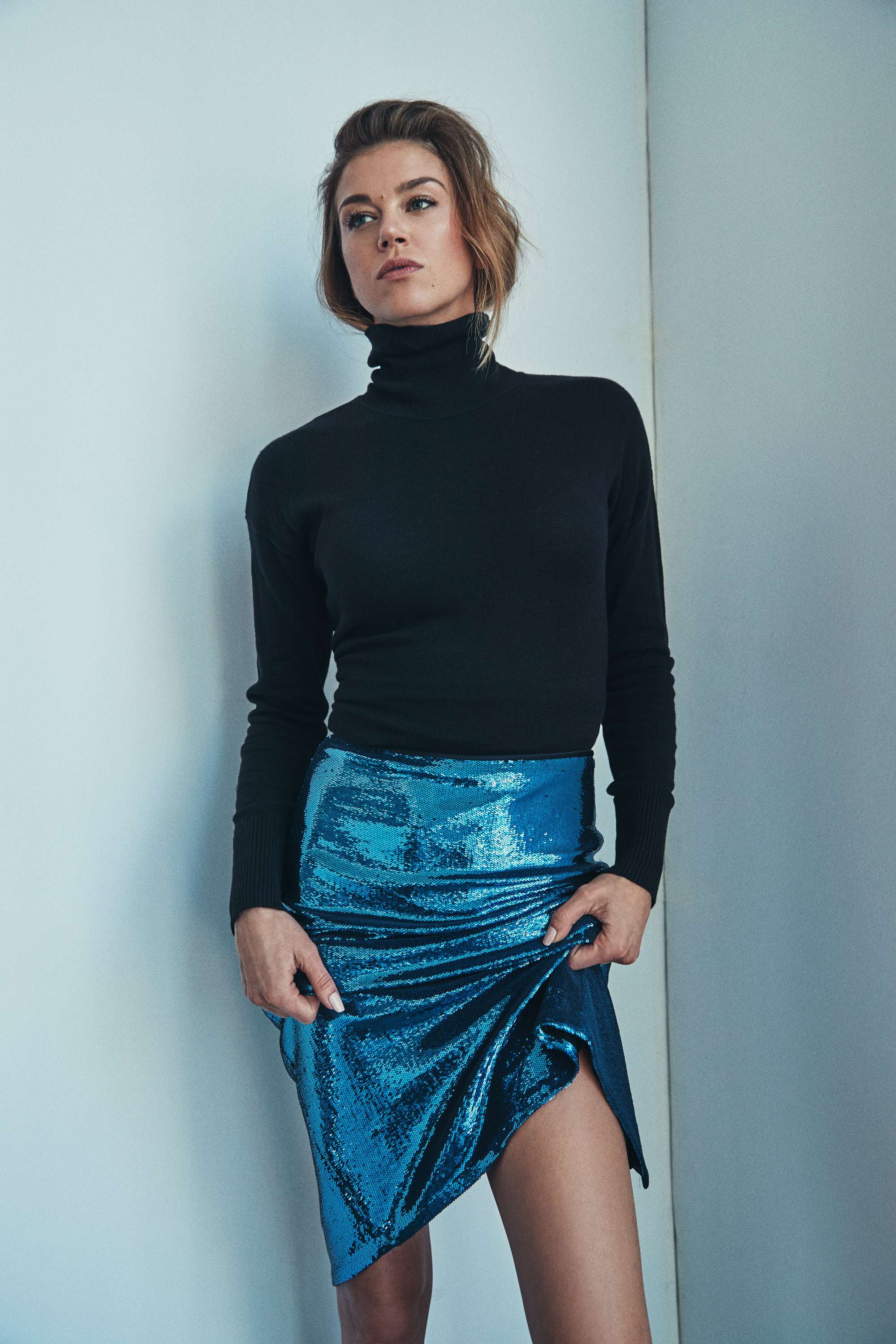 Turtleneck by   WOLFORD  ; Skirt by   DVF