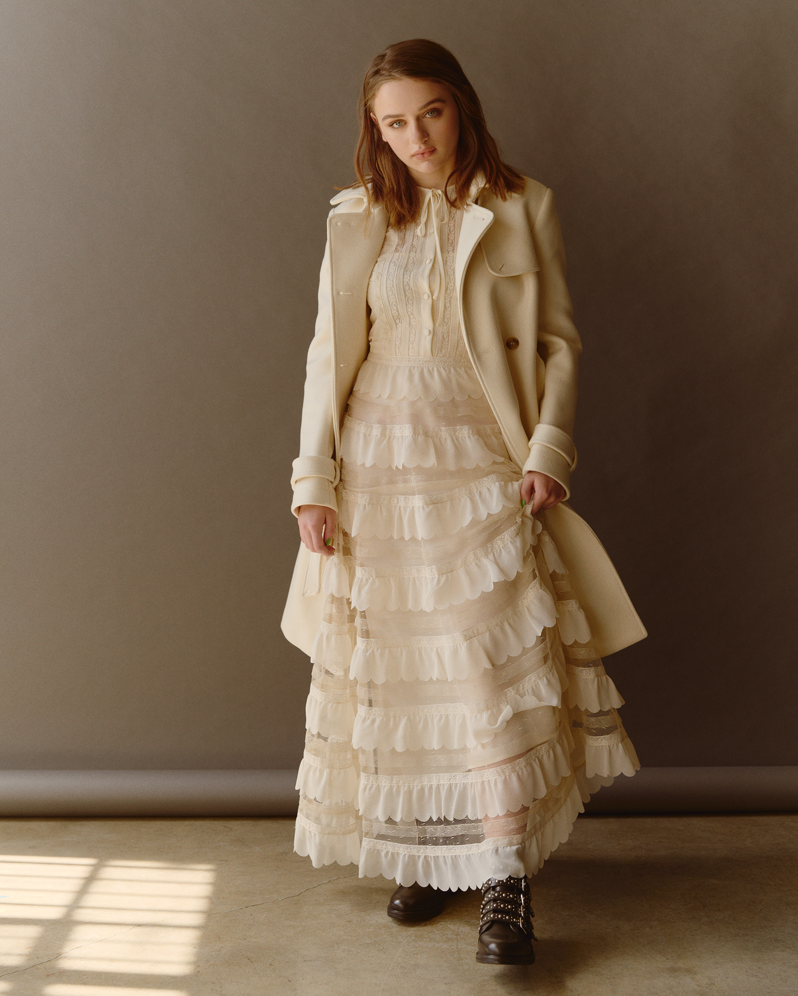Dress and coat by   REDVALENTINO  ;Boots by   MAJE   /   Bloomingdales Beverly Center