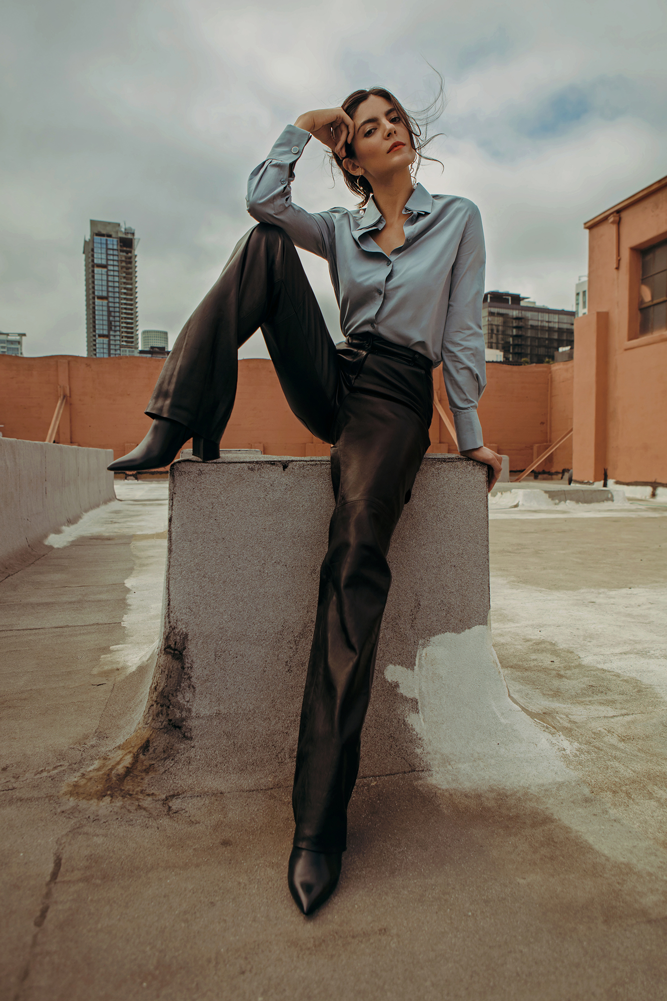 Shirt and trousers by   SALVATORE FERRAGAMO  ; Boots by   MARCO PROIETTI  ; Earrings by   ASOS