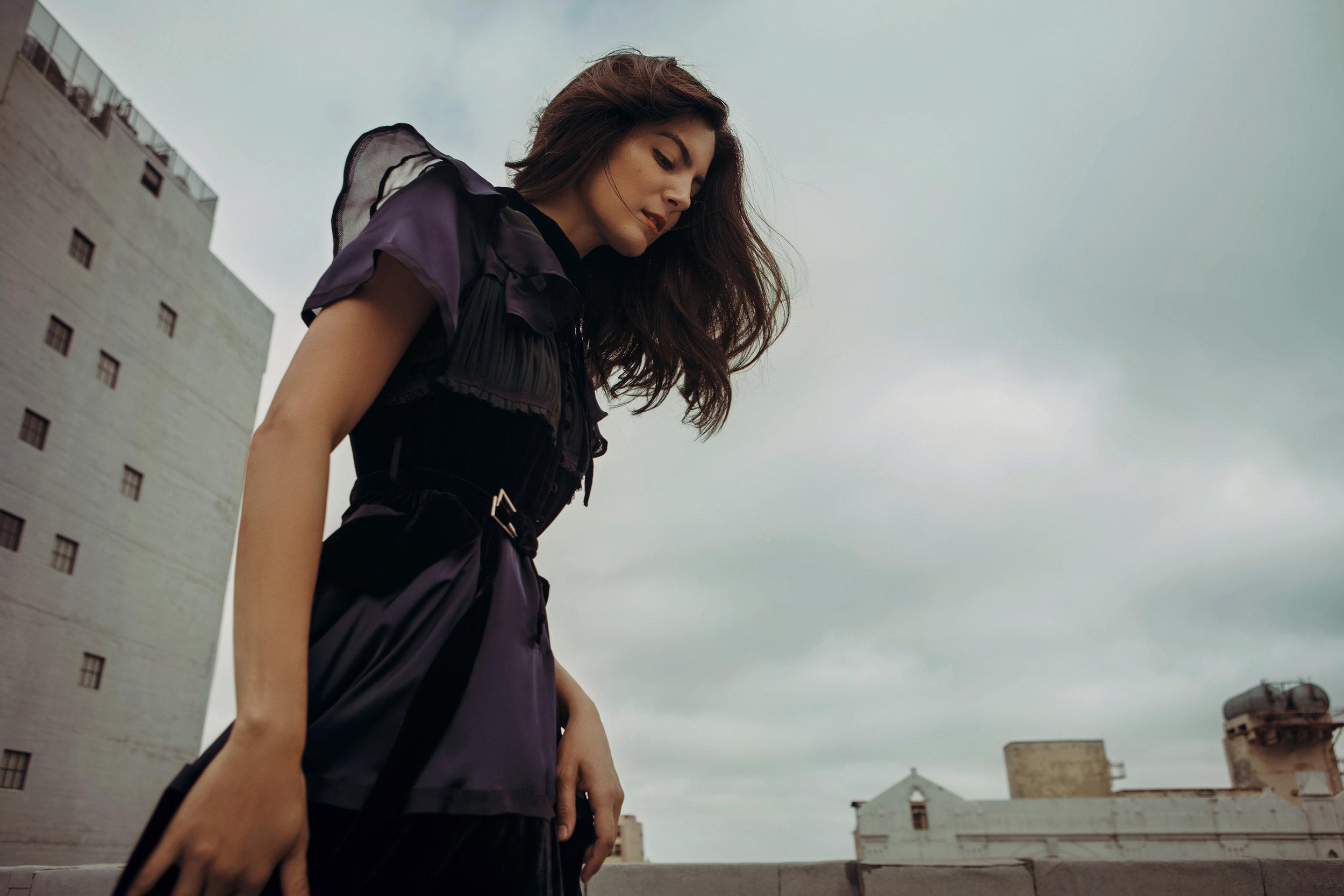 Dress by   SACAI   |   Barneys New York, Beverly Hills  ; Earrings by   JENNY BIRD