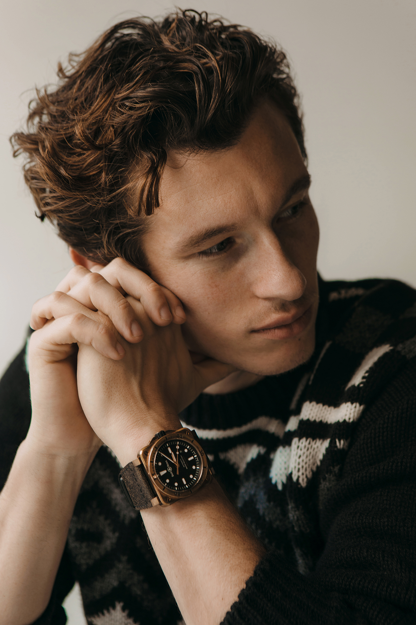 Sweater by   PRADA  ; Timepiece by   BELL & ROSS   |  BR03-92 Diver Bronze