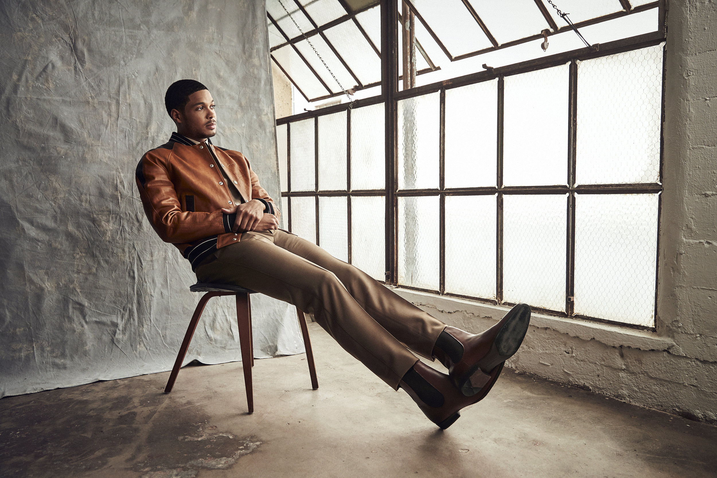 Jacket by   GIVENCHY  ; Shirt by   MAISON MARGIELA  ; Trousers by   LANVIN  ; Boots by   WOLF AND SHEPHERD