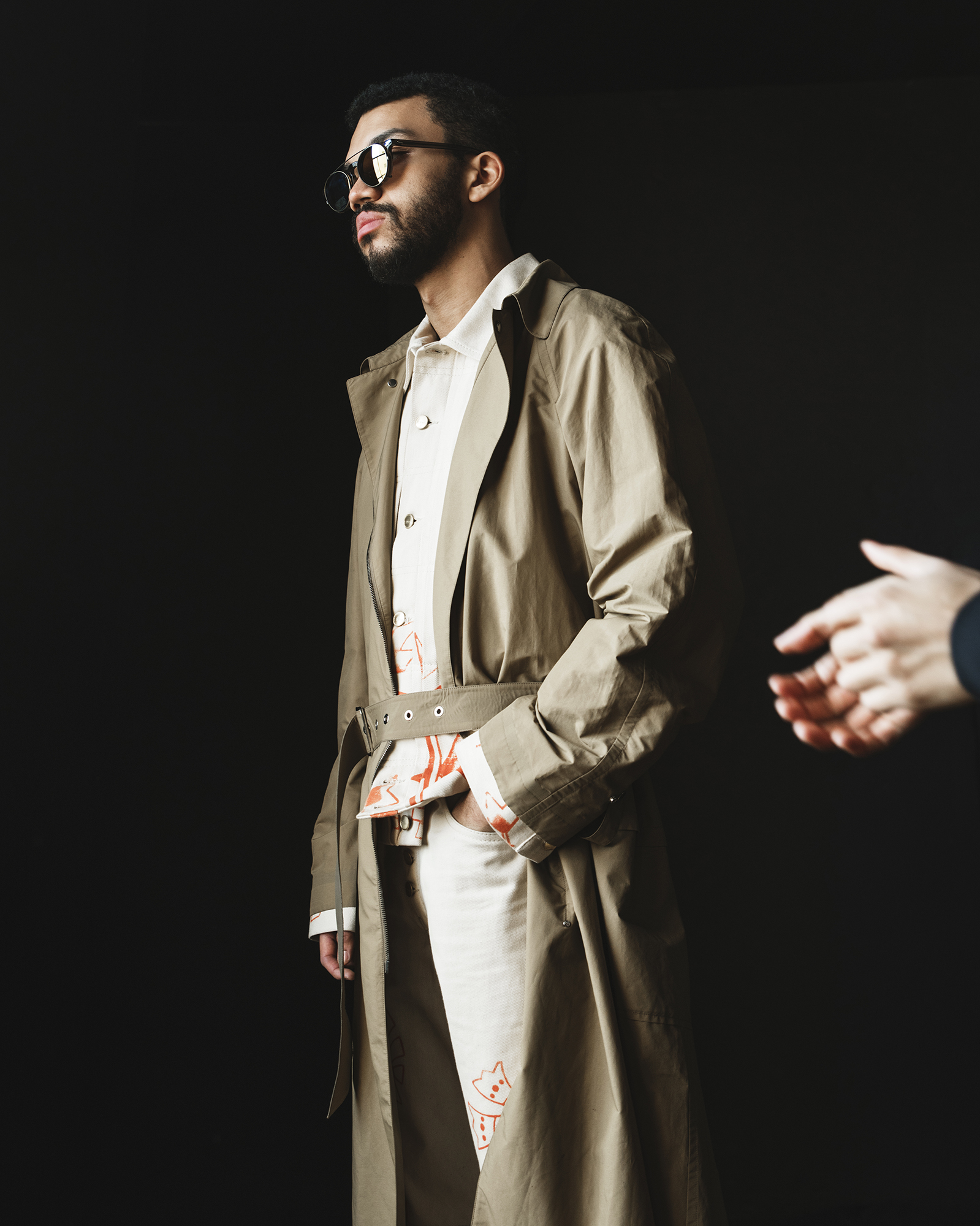 Coat by   SALVATORE FERRAGAMO  ; Jacket and pants by   LINDER  ; Sunglasses by   TVR OPT