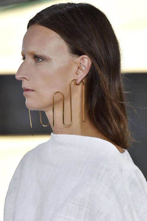 Brass sculptural earrings from Loewe, courtesy of Harper's Bazaar: http://www.harpersbazaar.com/fashion/fashion-week/g4400/best-jewelry-trends-spring-2015/?slide=8