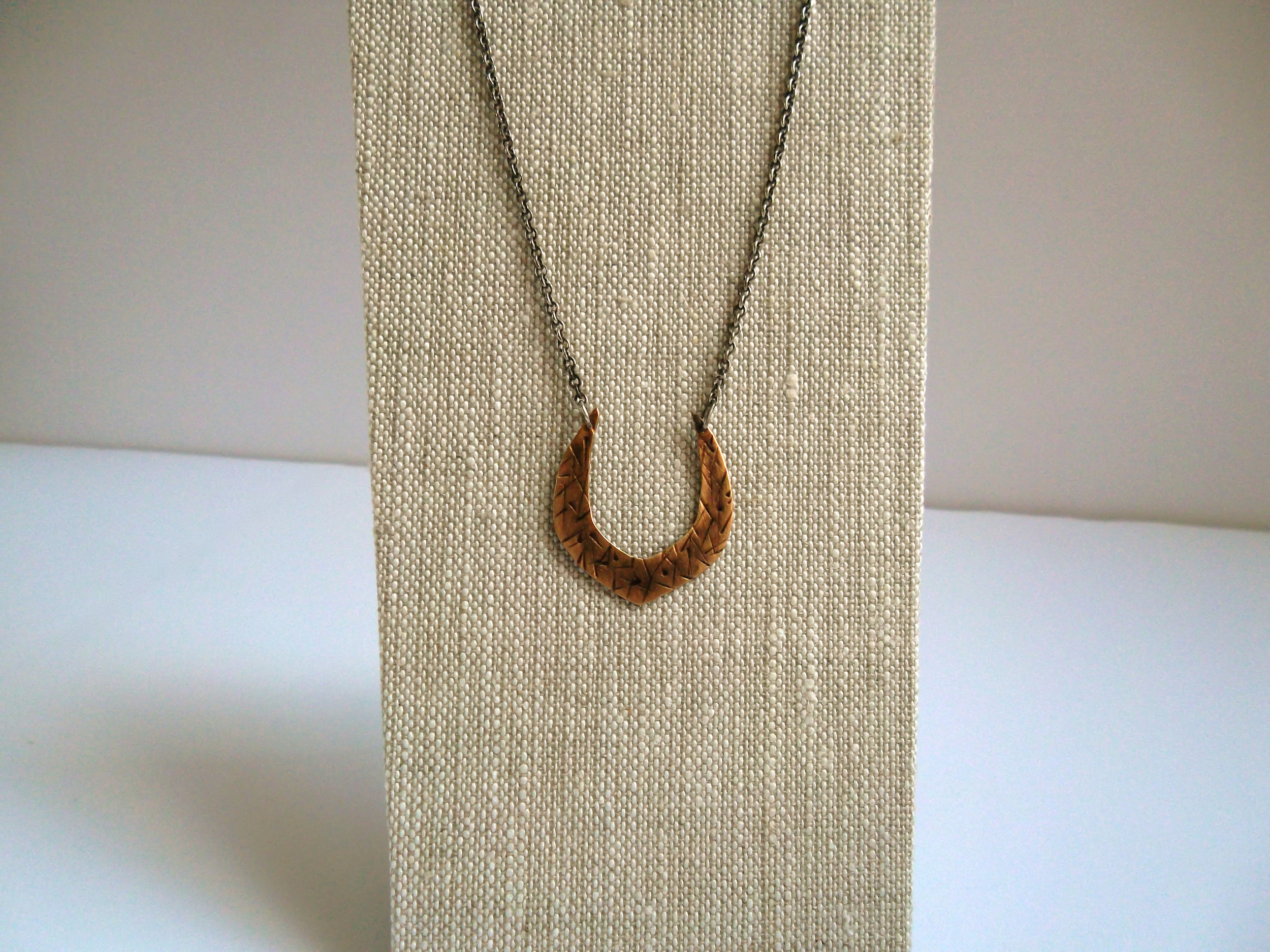 Blackened bronze and sterling silver horseshoe necklace