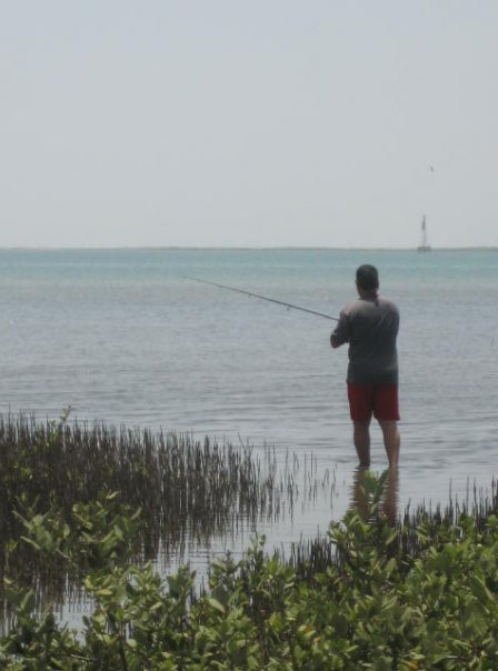 My dad, fishing at the island during the summer.