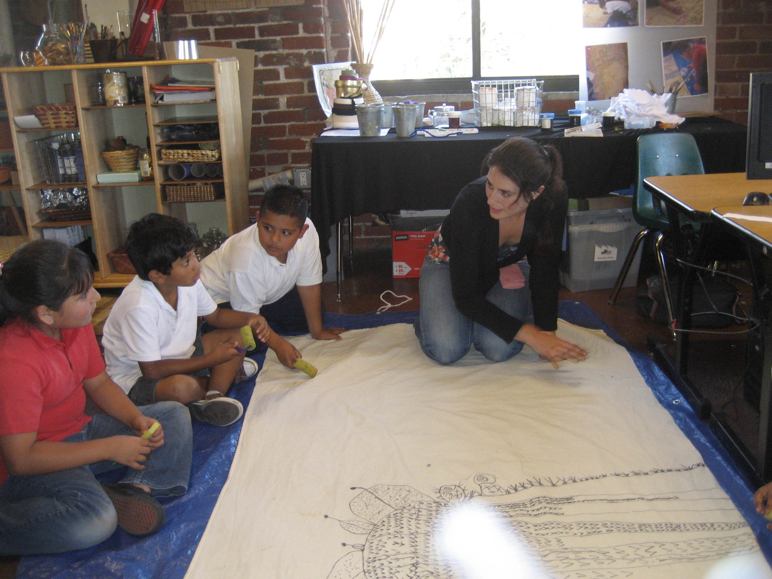 Working with a few students on a large Saguaro cactus mural.