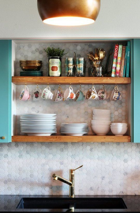 Just a few floating shelves for the prettiest mugs and dishes right?We considered more open shelving, in fact, we considered taking all of the upper cabinets out and having open shelves,but were afraid that it would look a little too busy and cluttered. Don't you love this backsplash?