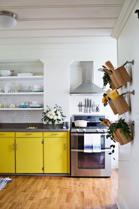 These cabinets! In our kitchen we had traditional cabinet faces, and not only did we not care too much for them, but the amount of time required to sand them would have taken much longer than building new doors and drawer faces. We decided to go with a modern / mid century design (similar to these beautiful yellow cabinets).