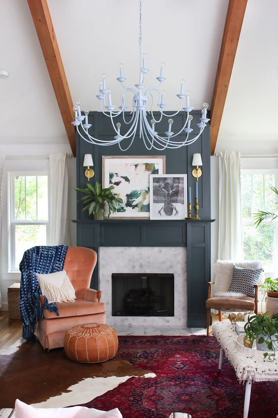 Painting the fireplace and mantle the same color allows the artwork to pop. All of the color, pattern and texture in this space is complemented by the black and white photograph. Nothing is more dramatic than a black and white photo.