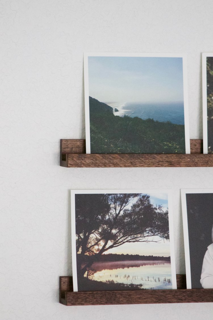 Our handcrafted photo rails and  Artifact Uprising  prints.