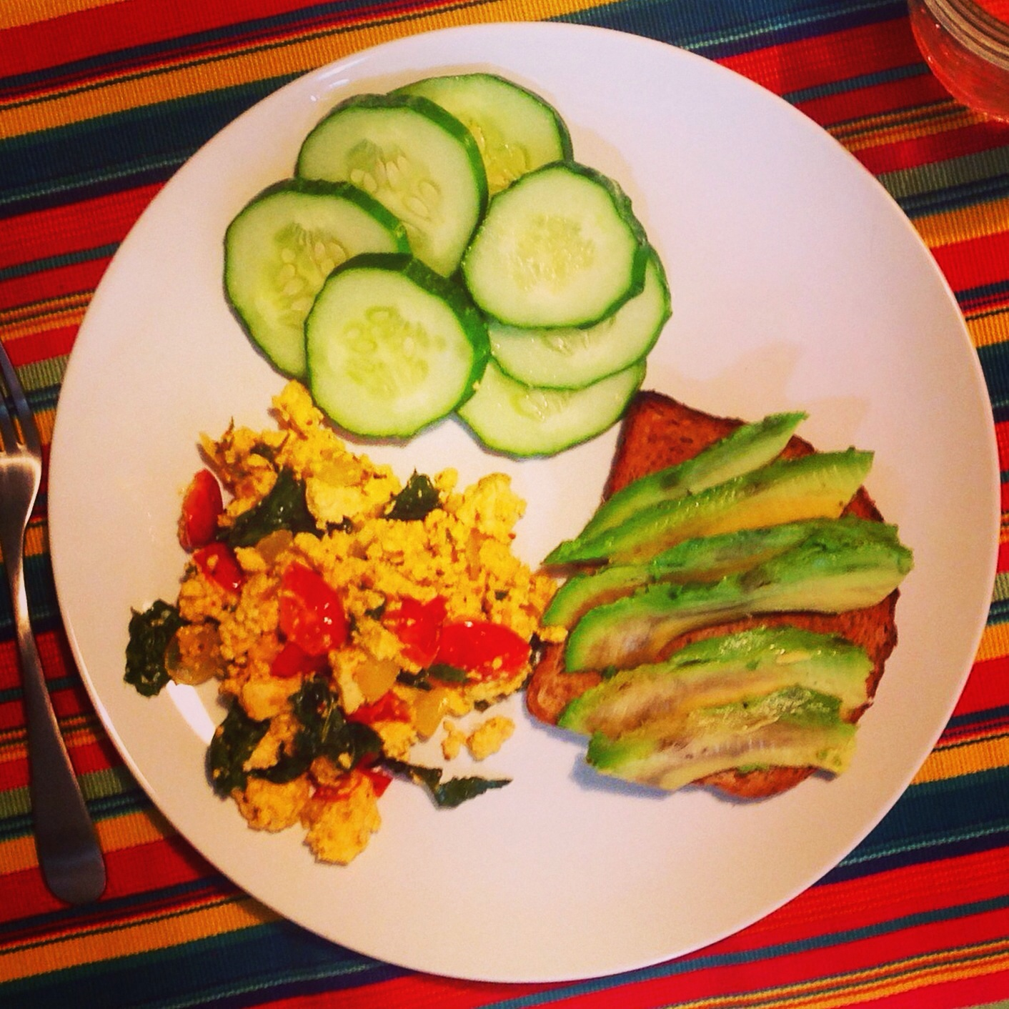 Tofu scramble with a side of cuke slices