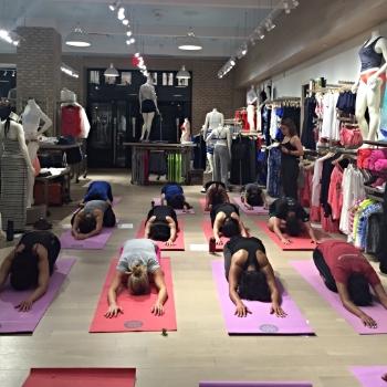 Leading a grounding yoga class.