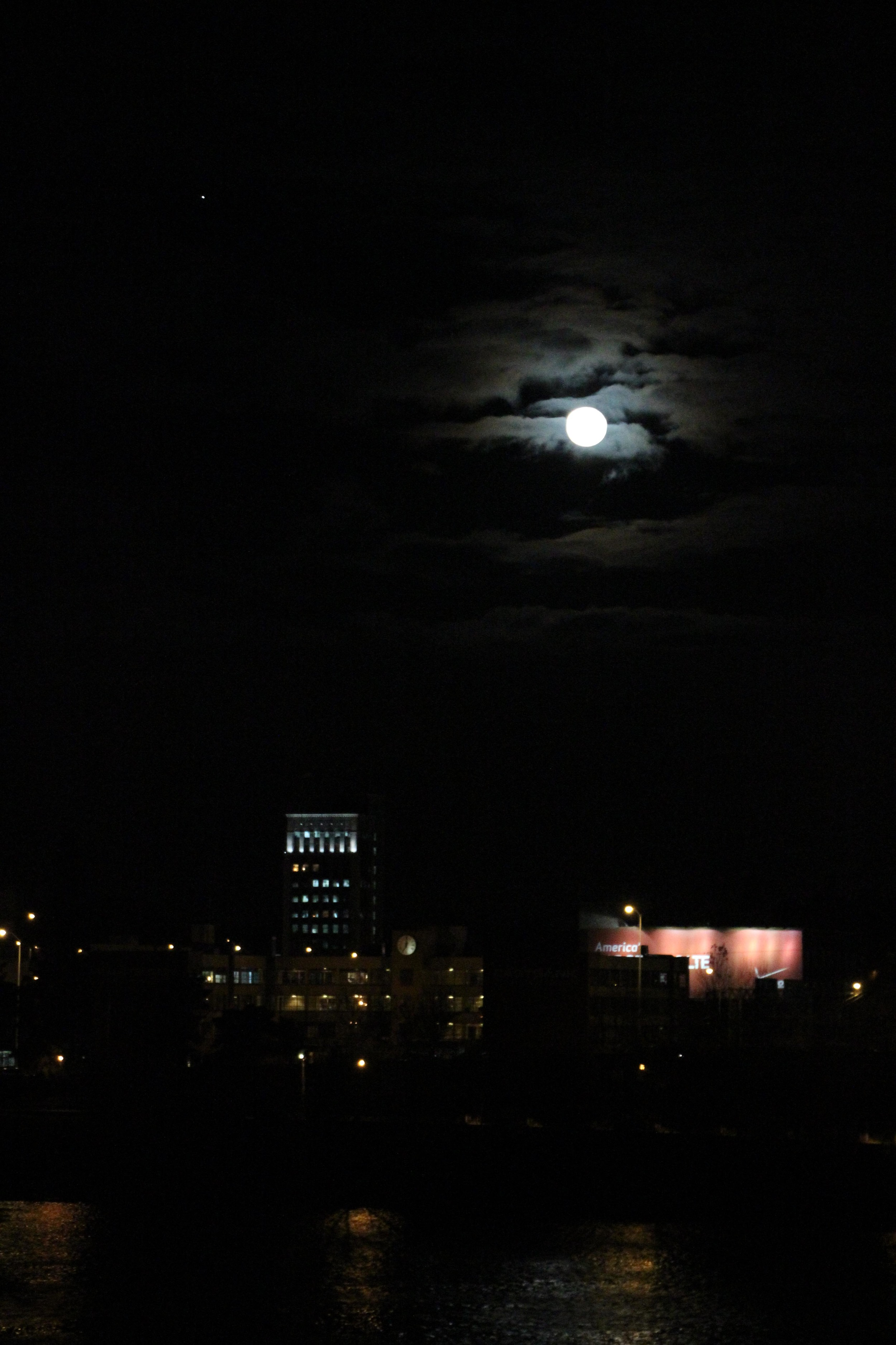 One of my first night shots. I like the way the moon illuminates the clouds, and the feel of the night skyline.