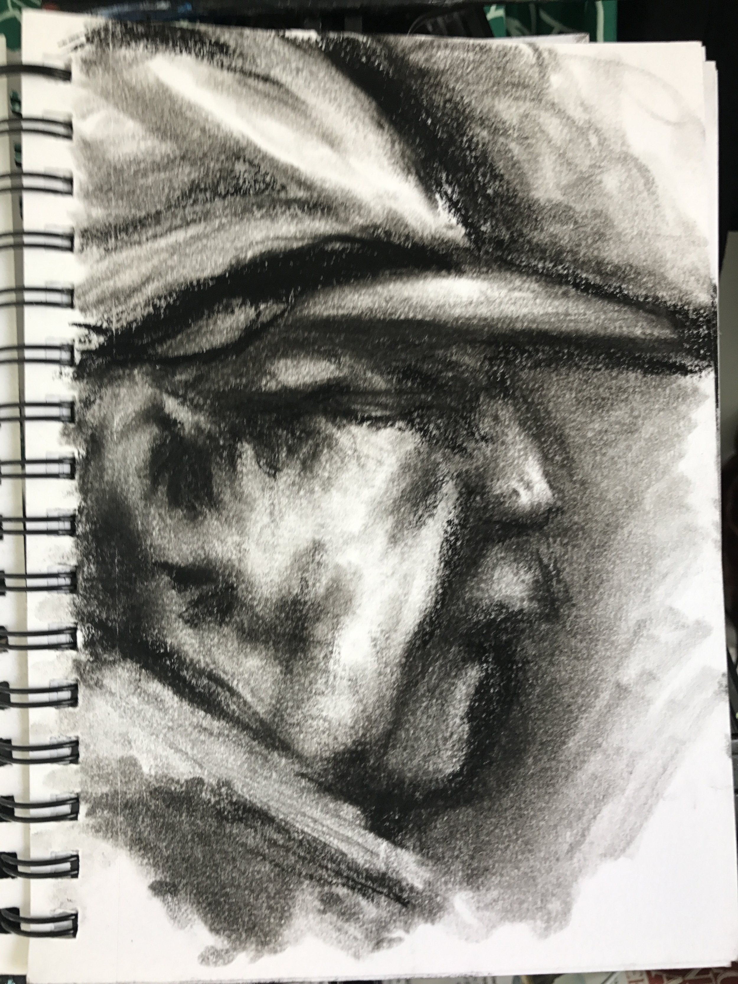 Charcoal sketch of Dave, our host
