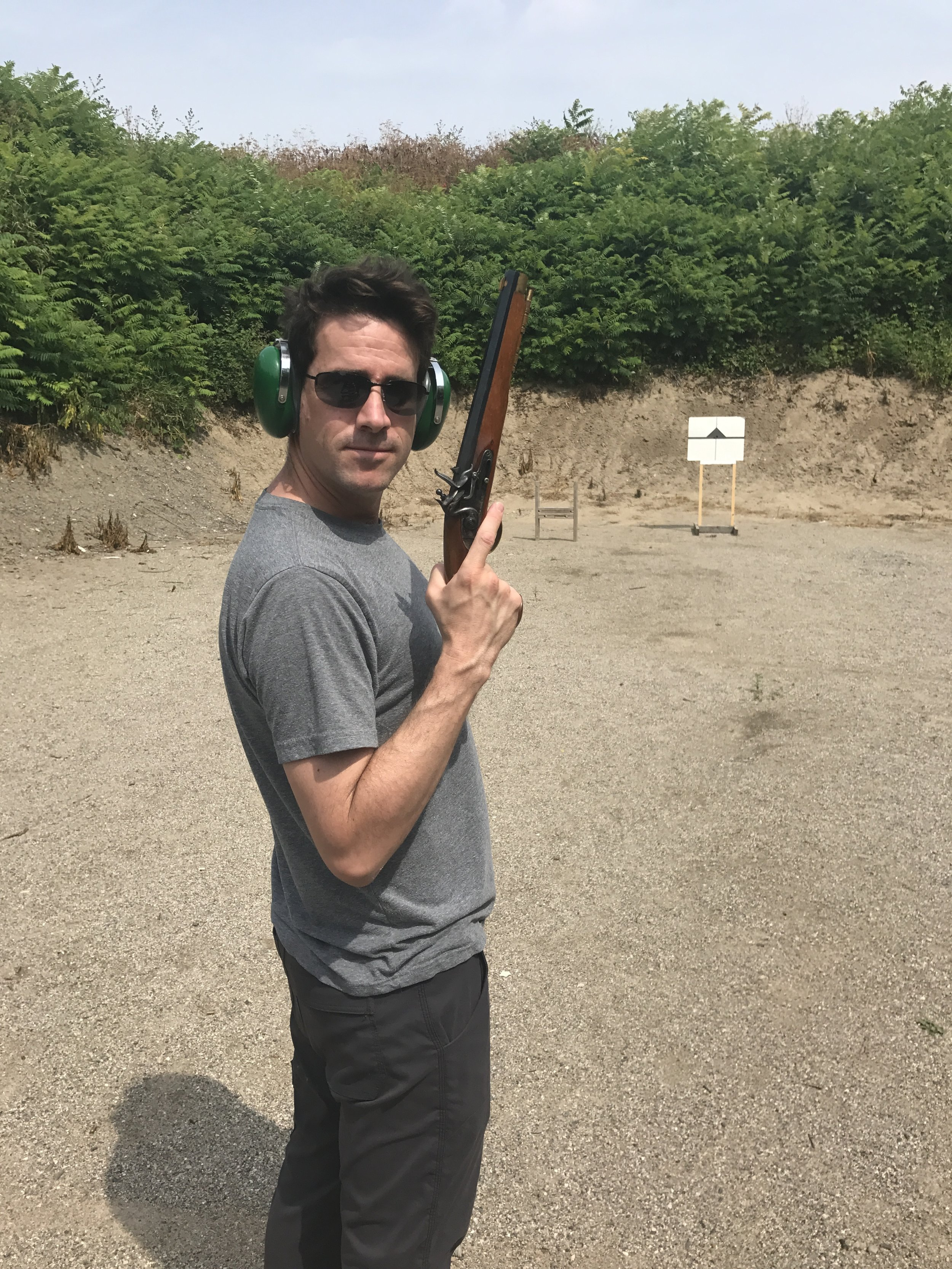 """Image of me with a flintlock pistol. Dave calls these """"hero shots"""". My sunglasses hide the terror."""