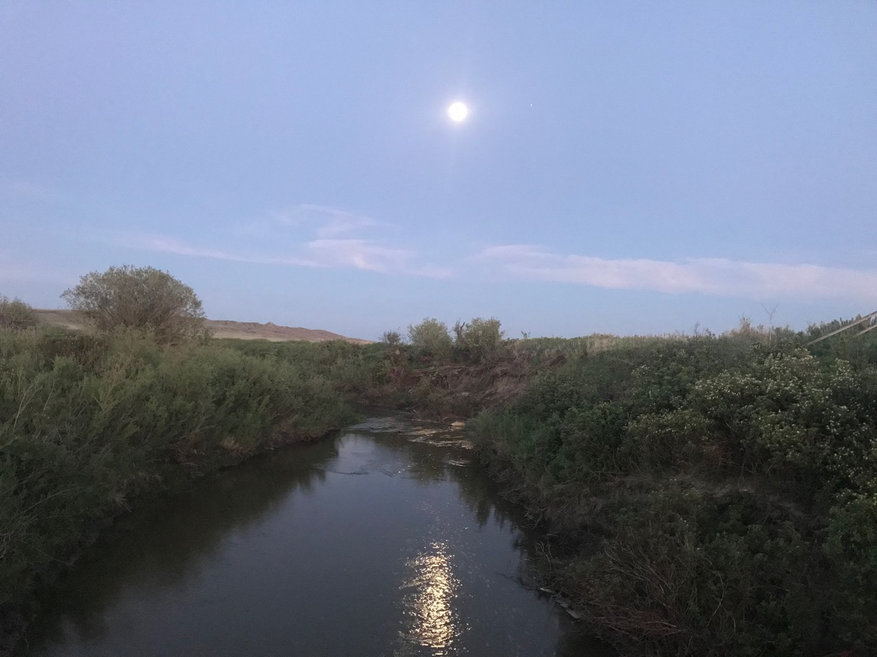 Moon and reflection.  Frenchman's Creek, Grasslands