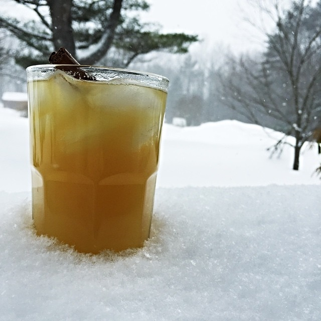 "Nothing beats the endless pounding of a good snowfall like Cider and another Super Bowl Championship! Her beverage of choice on a snowy day is called the  ""Strange Brew"" It's made up of gin, cinnamon bark, simple syrupy, pineapple juice & Shed IPA. GO PATS!"
