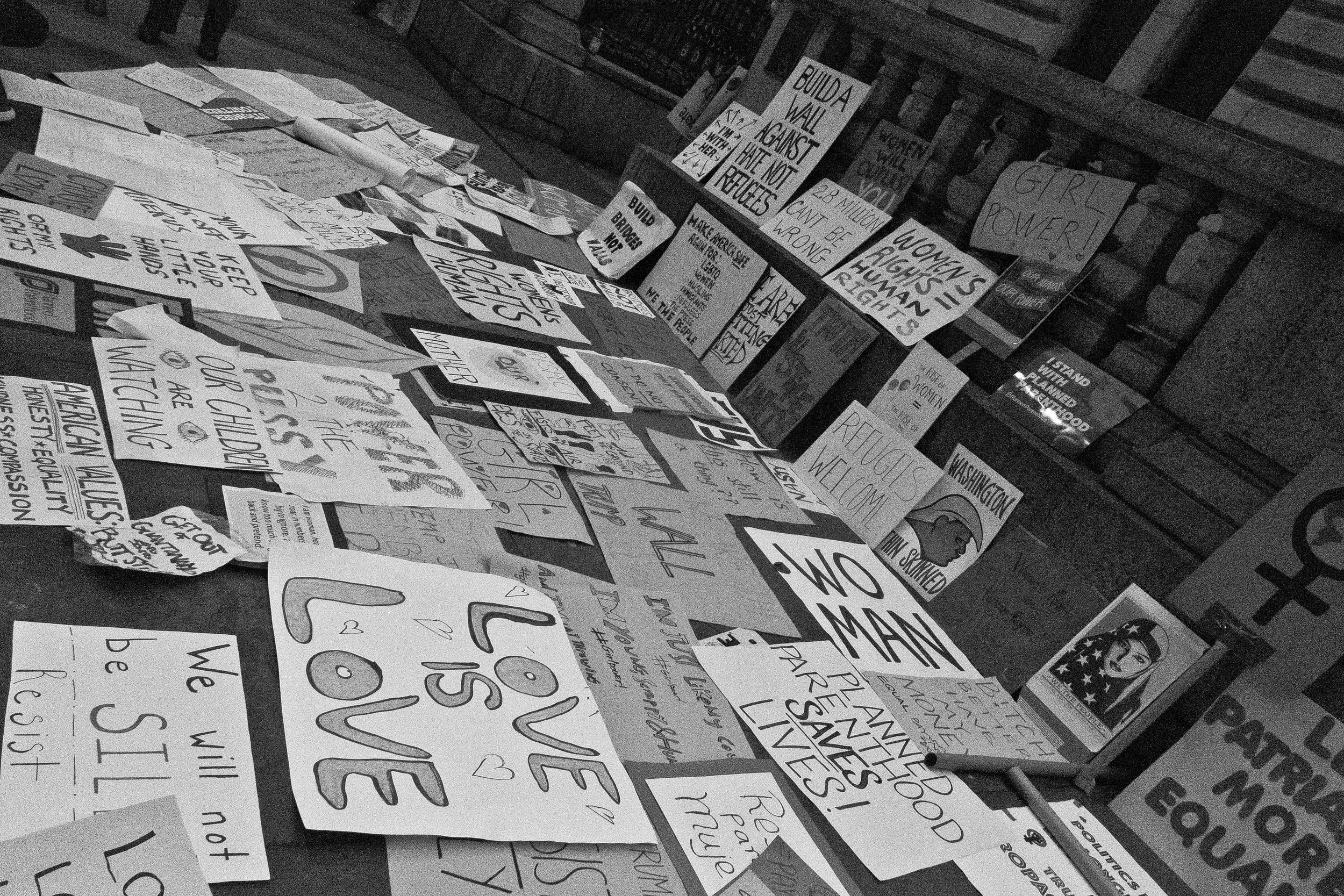 Marchers dropped their signs outside of the New York Public Library on 42nd Street - creating a collage of messages representing the goals and demands of the NY marchers.
