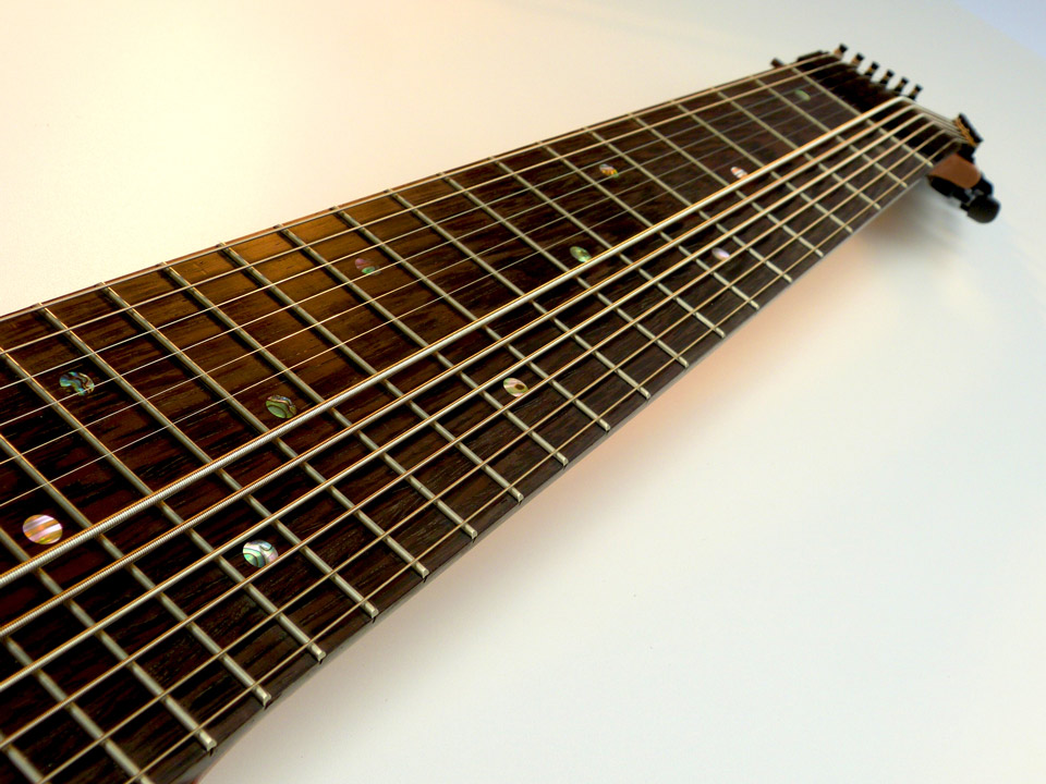 With this tuning, you have identical home-position notes at fret 2 (double dots) on the bass side and at fret 12 (double dots) on the melody side.  With the same notes under both hands, straight 4ths, and the strings arranged like a standard guitar or bass, understanding the geometry of the fretboard and unlocking the secrets of it's harmonic patterns is surprisingly easy.      Other popular tunings include Chapman Stick style  tuning in Inverted-Fifths, bi-melody, dropped, and mirrored tunings.   Plus all of these in an uncrossed string arrangement if desired. Normally free of charge.    Of course, the tuning and string arrangement can be customized to suit your style and background.