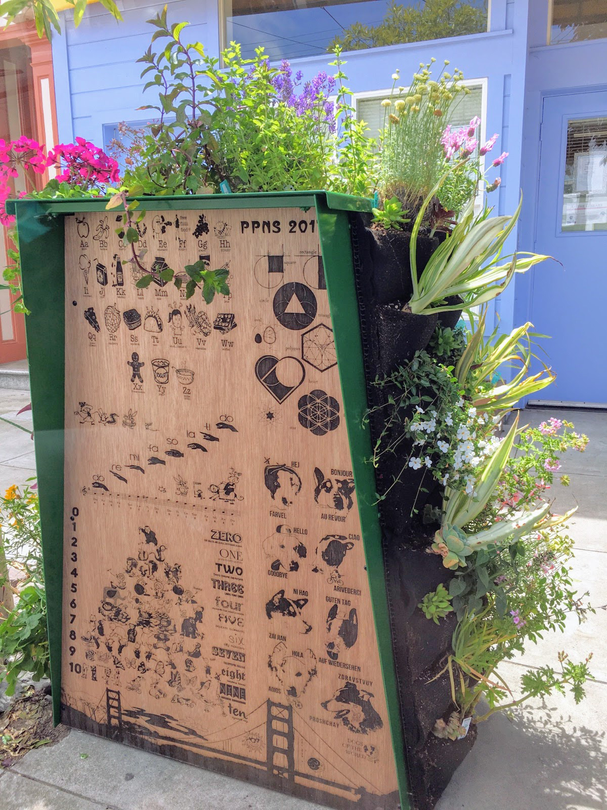 Tiny Library designed by landscape architect Alec Hawley using Florafelt Vertical Garden Planters