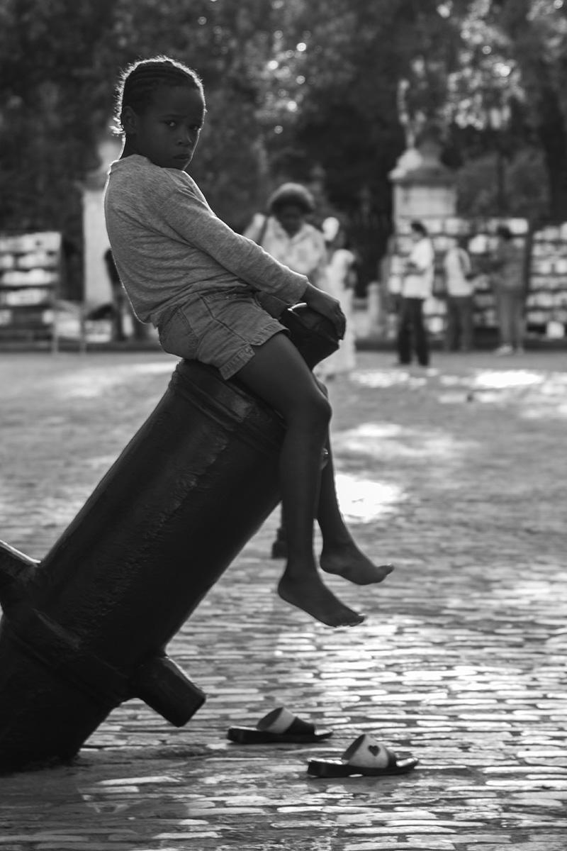 girl on top of the cannon. Old Havana, Cuba 2010