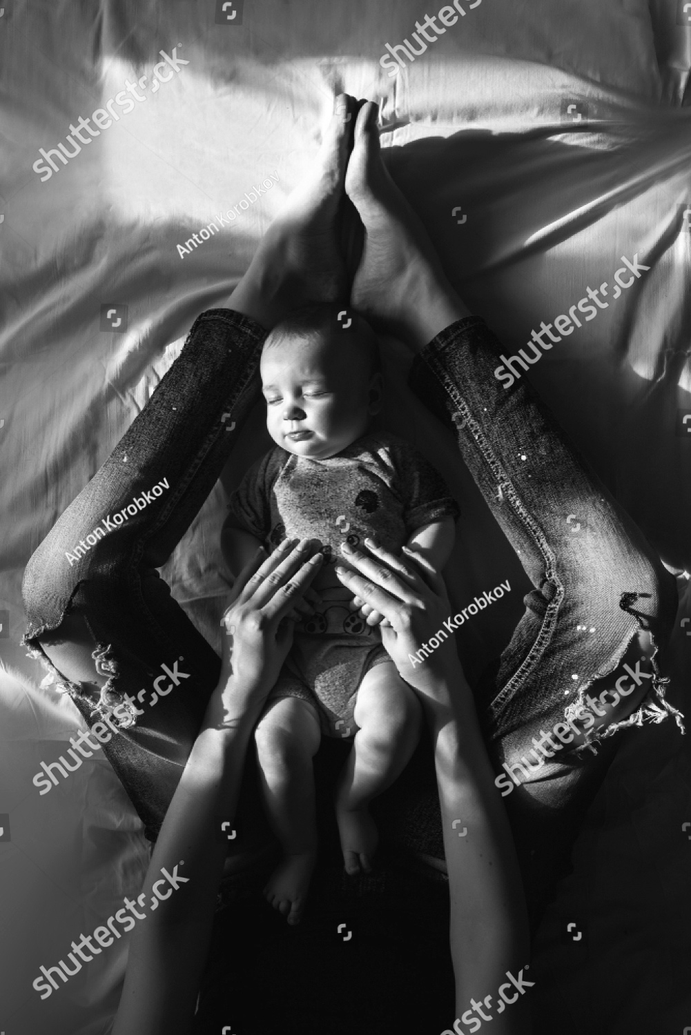 stock-photo-top-view-of-beautiful-young-mom-and-her-cute-little-son-lying-on-white-bed-linen-mom-holding-her-1280253340.jpg