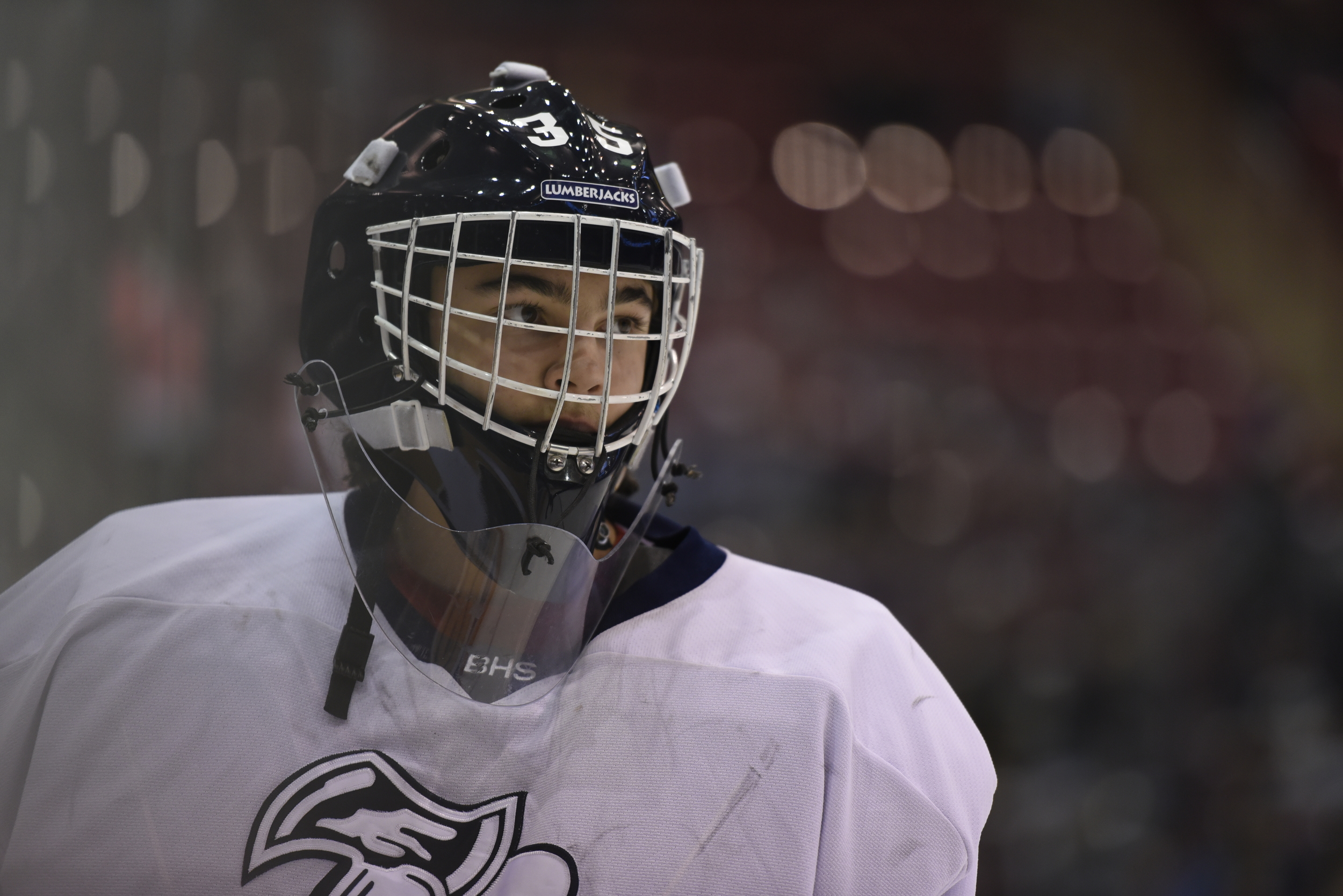 The Lumberjack goalie eyes the crowd during the consolation championship game in the 2016 Minnesota State Hockey Tournament.