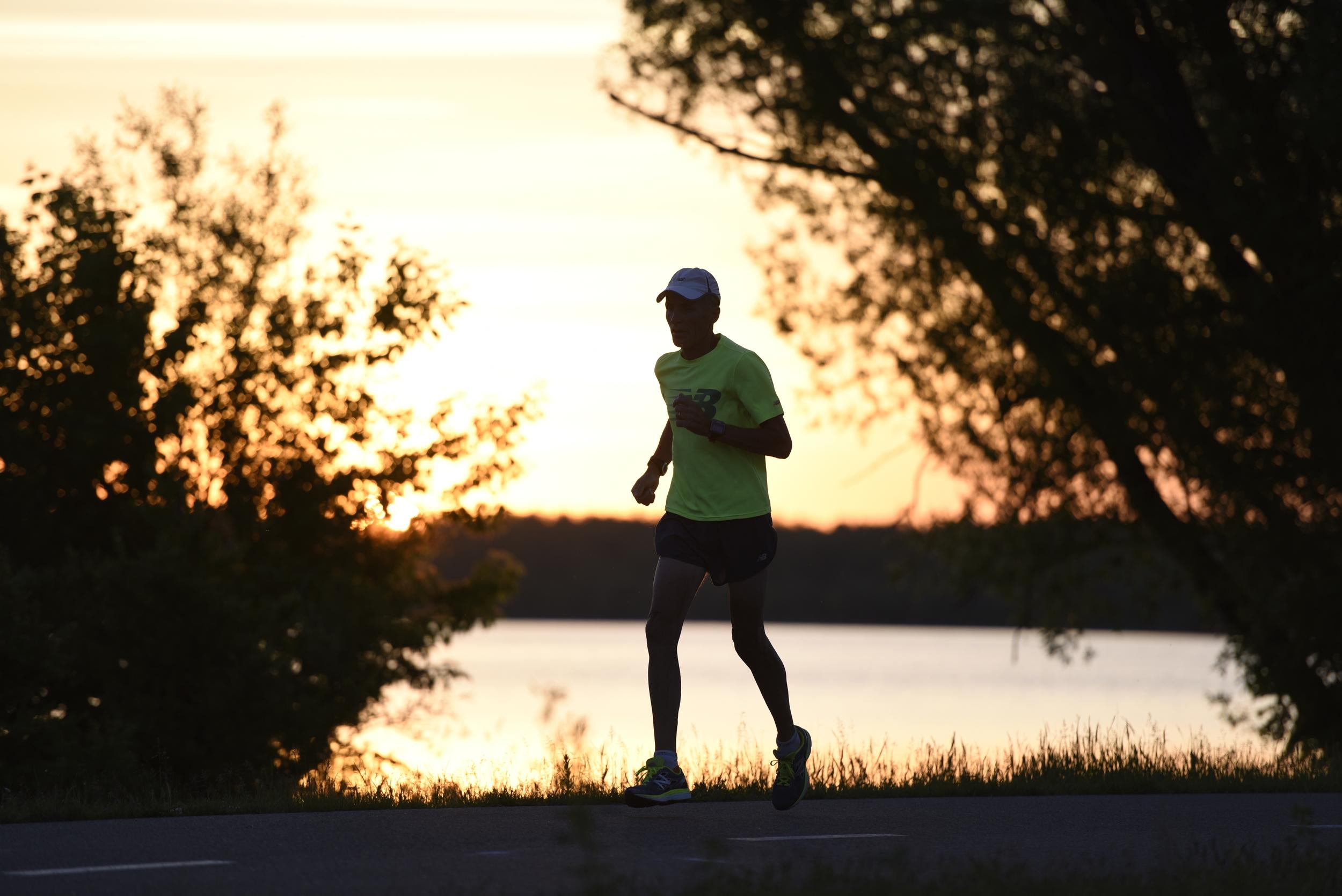 Dick Beardsley runs along the Paul Bunyan Trail as the sun rises in Bemidji. Beardsley was featured in a special 40th Grandma's Marathon edition of the Duluth News Tribune.