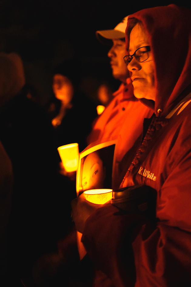 Kristy White, sister of Rose Downwind who was murdered in Bemidji in October 2015, listens to the drum circle at the candlelight vigil held for her sister.