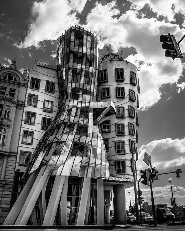 Ginger and Fred are still dancing in Prague #Prague #Praha #Czechia #Europe #Gehry #composition #deconstructivism #facade #building #lookingup #architecture #architexture #architecturelovers #architecturaldesign #archdaily #arquitecto #archidaily #architoral #design #dance #bw #bnw #blackandwhite #instablackandwhite #vscoph #HDR #traveling #torontophotographer #matviyenko #neontie