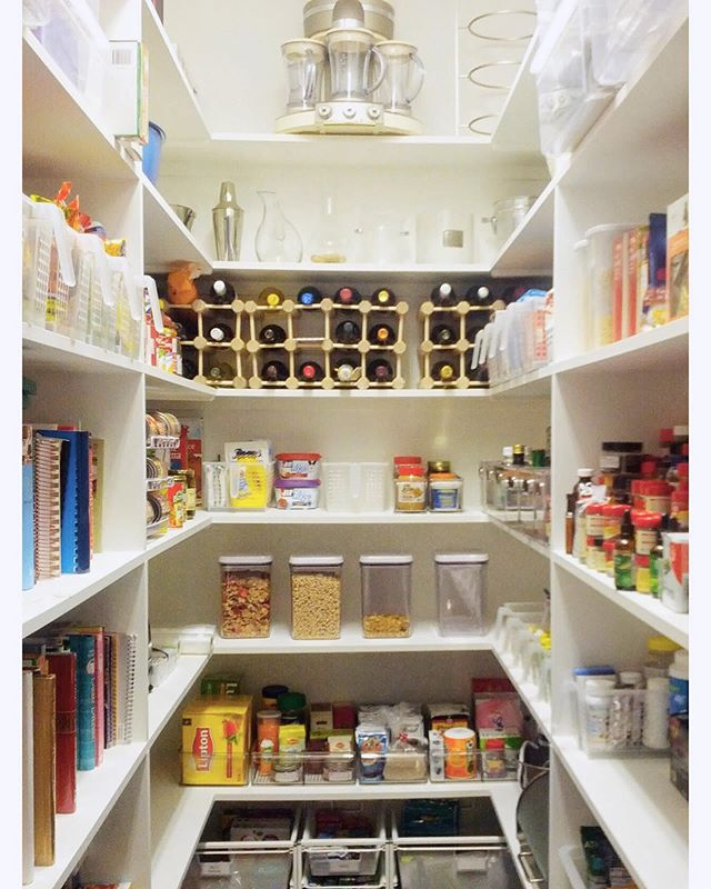 All clean and tidy! Things we love about this pantry: floor space used for drawers, wine front and center 😉, snack sprawl eliminated by plastic baskets (read: easy to reach, easy to clean out the crumbs!) #pantrygoals #organizedpantry #organizedlife #oldspacenewspace #homeorganizer #homeorganizing #professionalorganizer #containedhomeorganizer #containyourself #getorganized