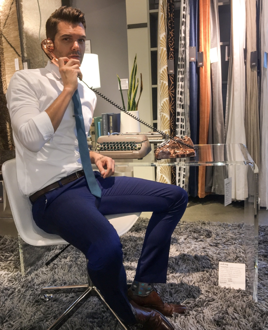 Testing out a chair at CB2 that did NOT make the cut. Who on earth can sit at a desk in a chair with no arms? NOT THIS GUY!