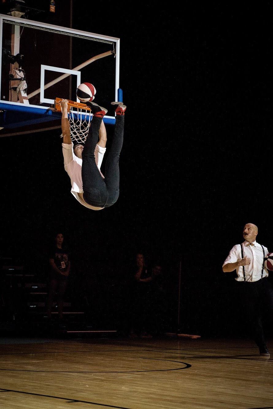 Gian Marco Oddo Preforimg a dunk with his feet.