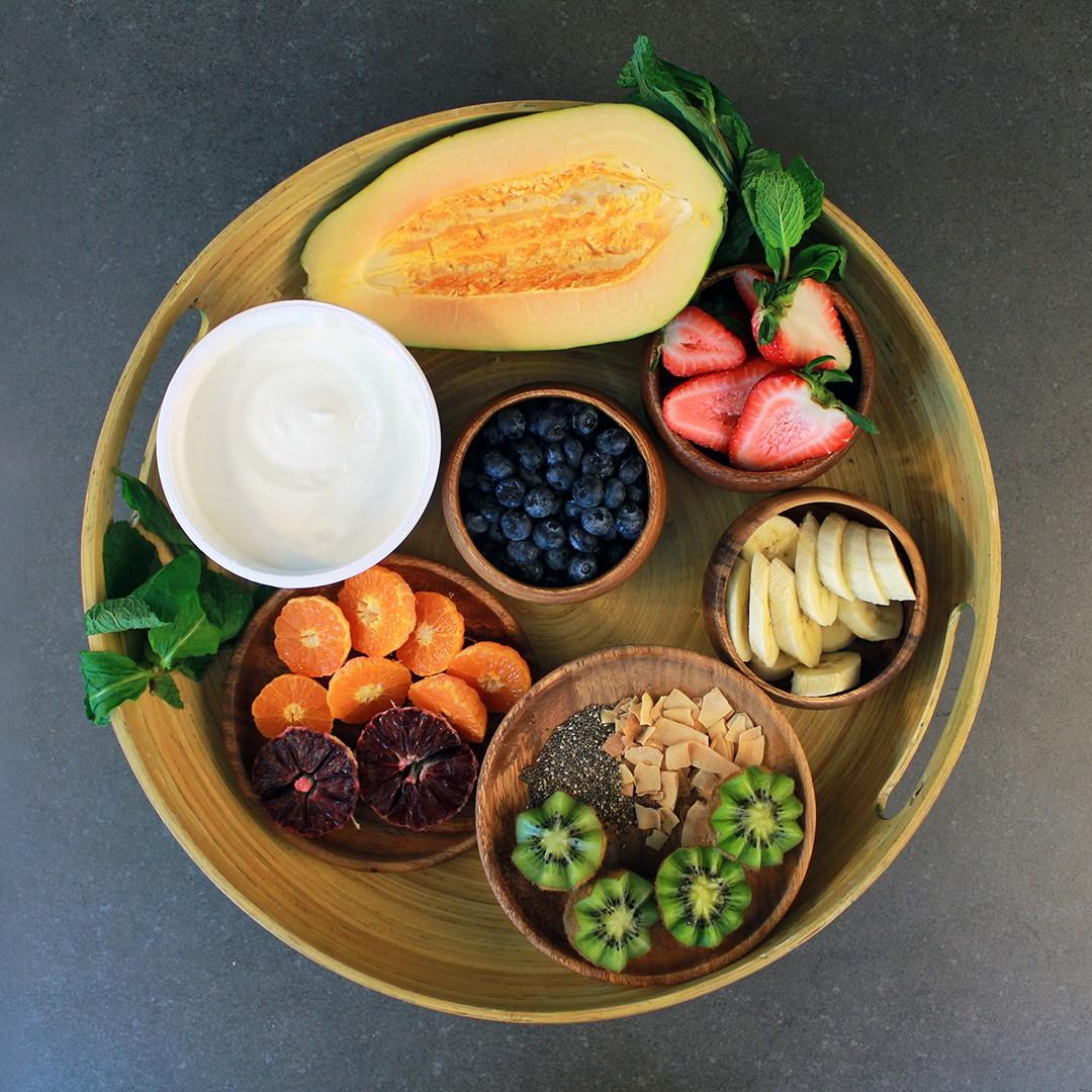 Tray of ingredients for the papaya yogurt bowl.
