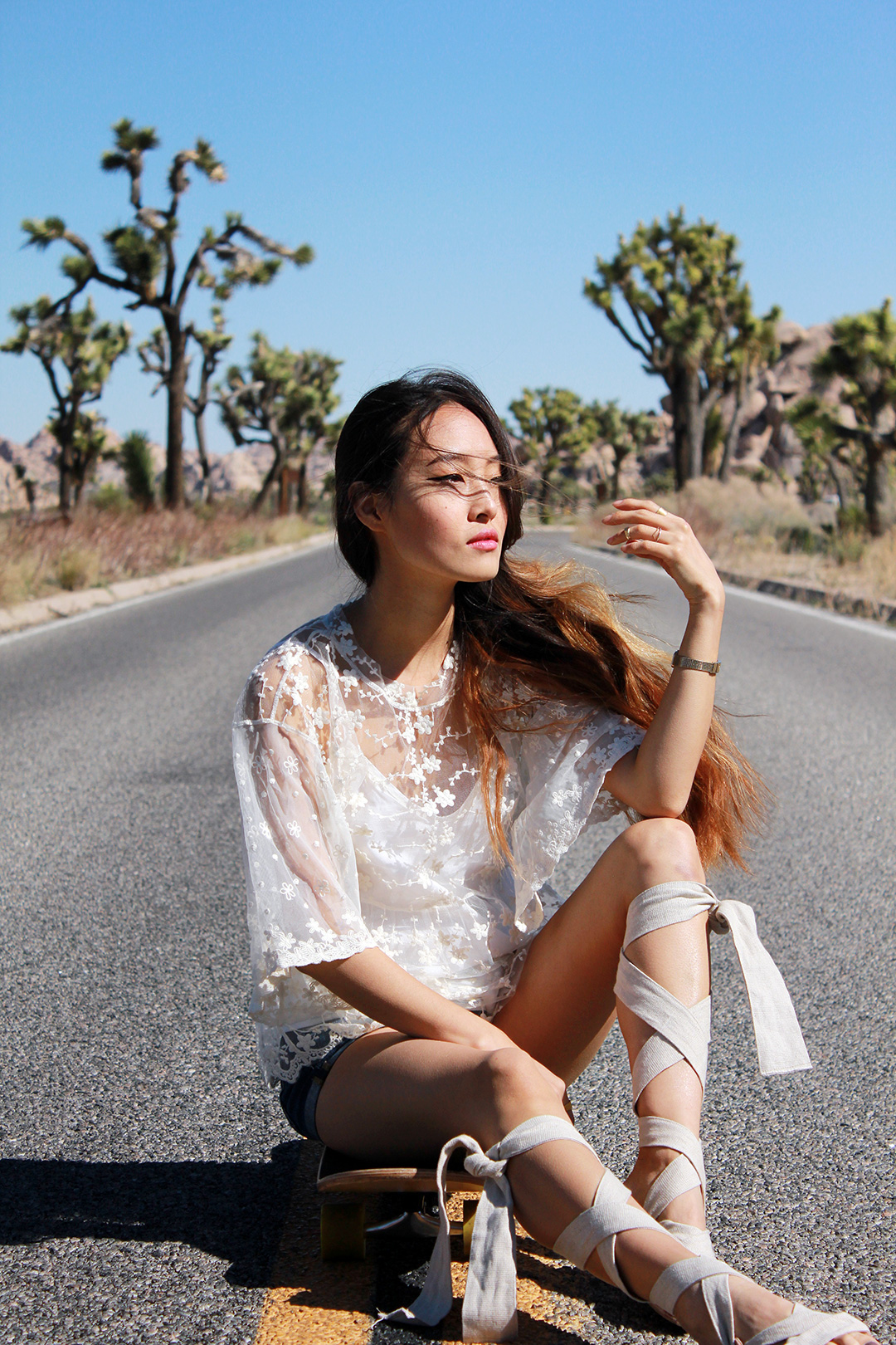 Zara lace top, AG Jeans denim shorts, Brother Vellies linen sandals