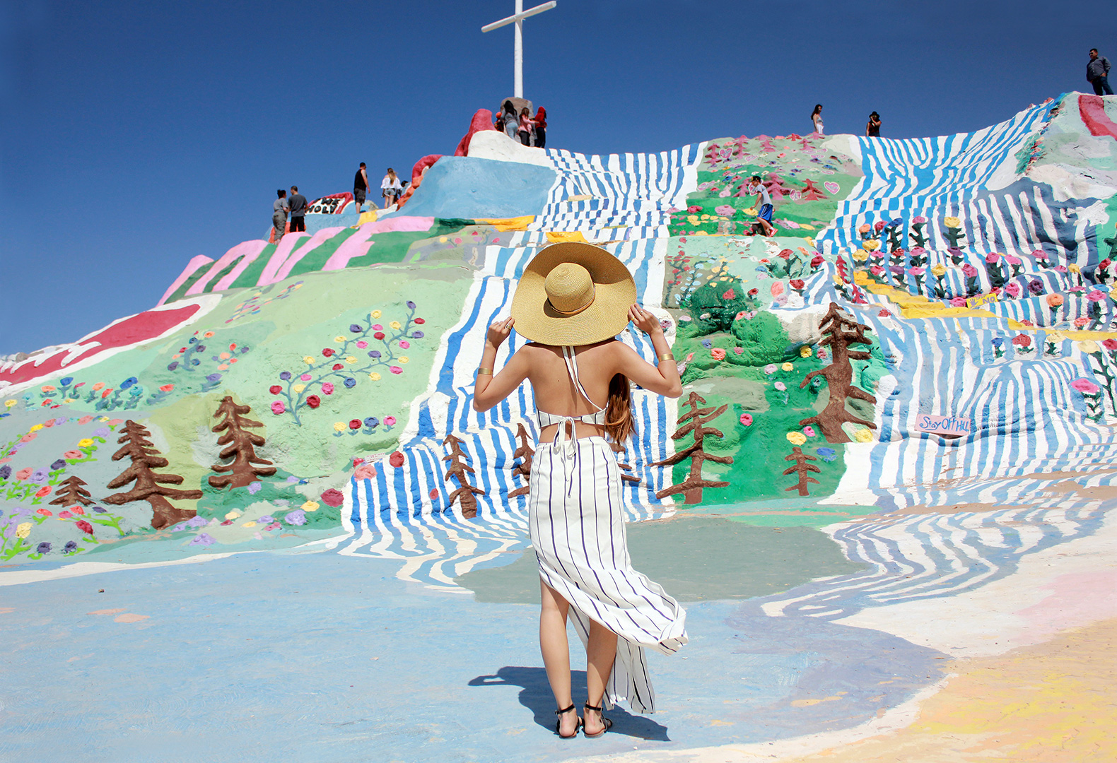 Taking in the beautiful landscape of Salvation Mountain. Dress by Tobi, J. Crew sandals, Nine West hat, Madewell cuff bracelets