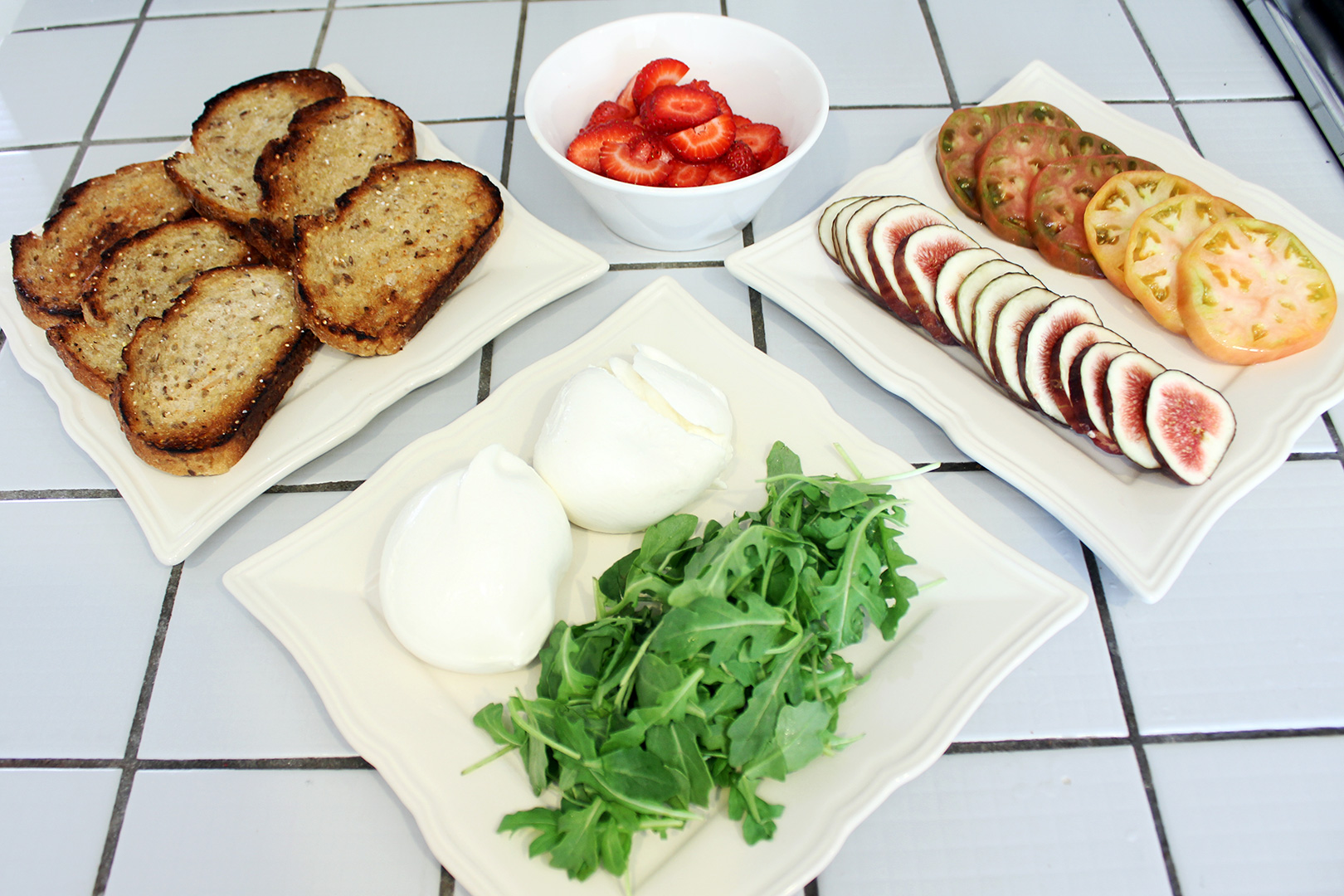 Burrata Toast ingredients and toppings spread out for easy assembly.