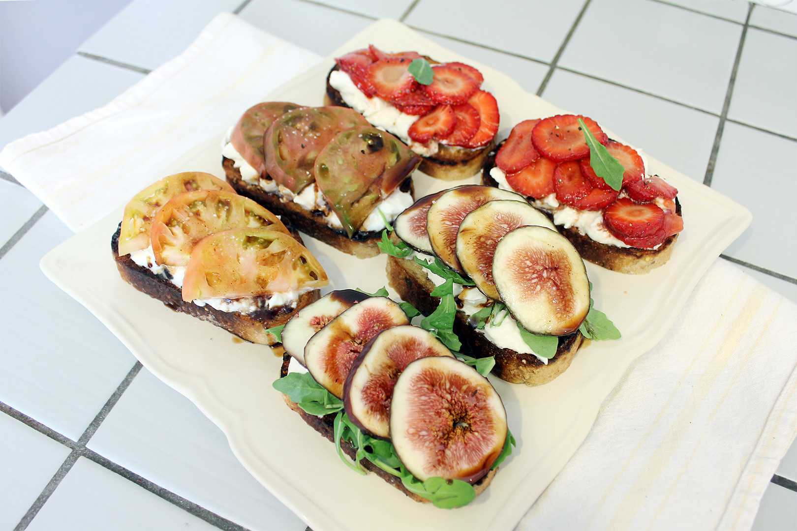 1. Burrata Toast with figs, arugula and balsamic glaze 2. Burrata Toast with strawberries and balsamic glaze 3. Burrata Toast with heirloom tomatoes, basil leaves, and balsamic glaze