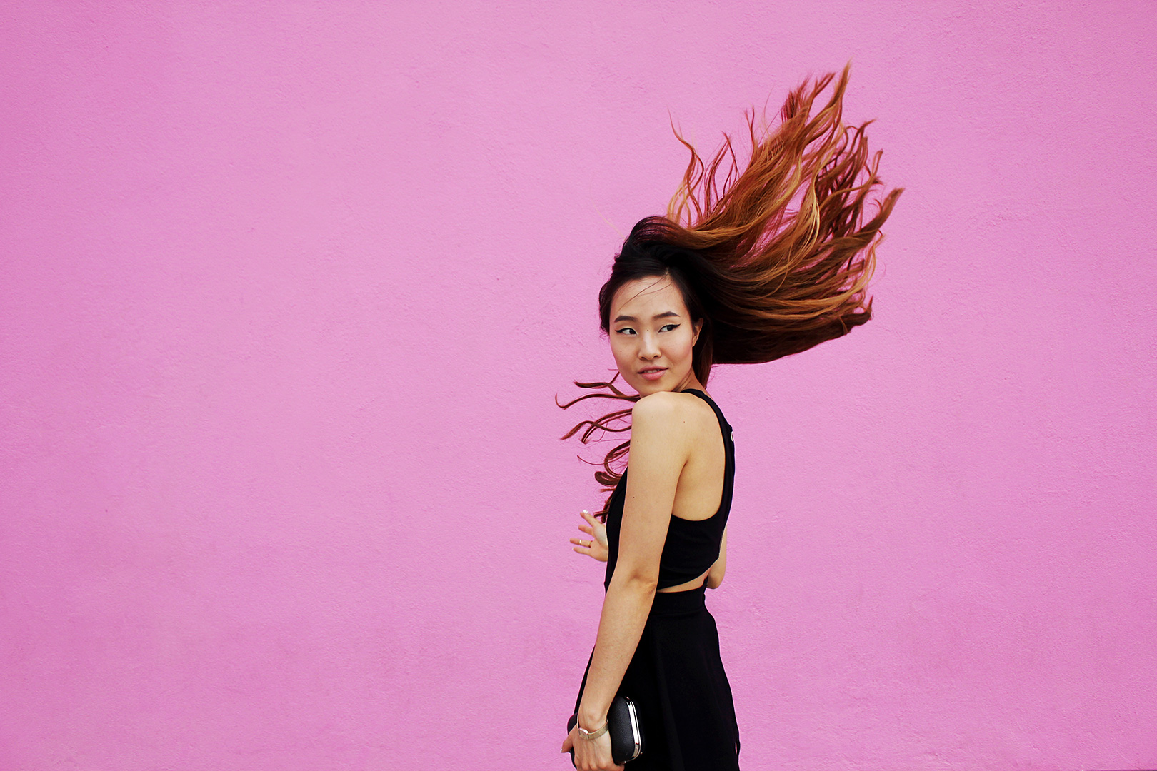 Hair tosses in front of the pink Paul Smith store! - Romper by Nasty Gal